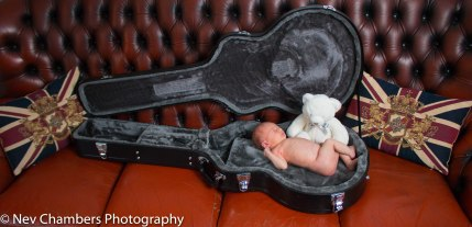 family, photoshoot, Hunmanby, North Yorkshire, fun, giggles, Castleford, proud parent, natural, love, newborn, first born, guitar case, teddy, pink, special time, magic, Nev Chambers Pho