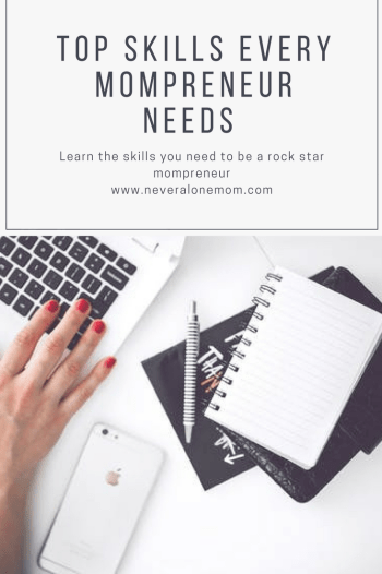 Woman's hand on desk - the skills a mompreneur needs | neveralonemom.com