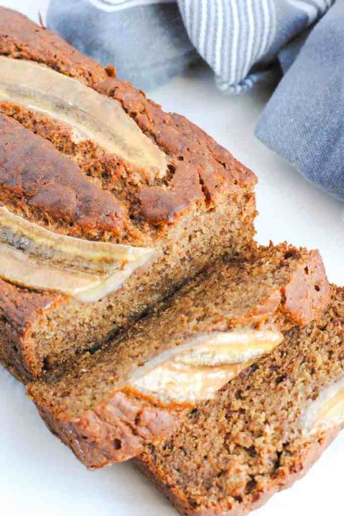 slices of whole wheat banana bread on a light background