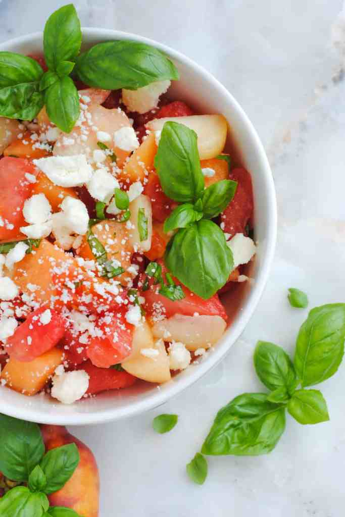 watermelon, basil, feta salad with peaches, tomatoes and melon
