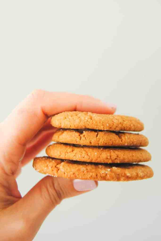 hand holding a stack of ginger cookies