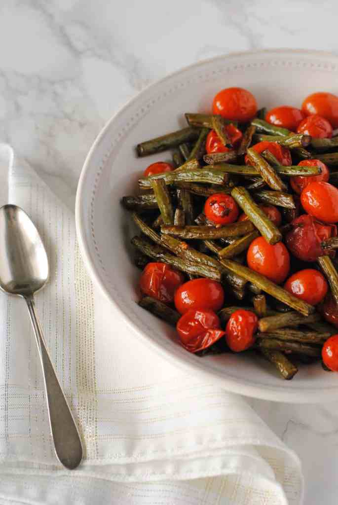 green beans and tomatoes in serving dish