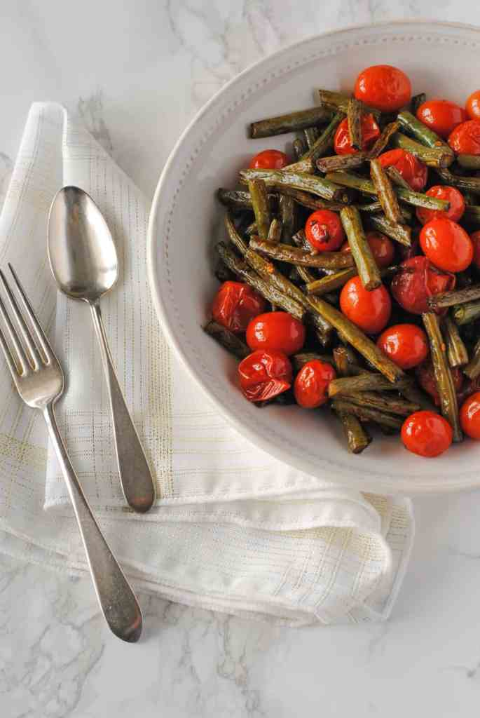 Balsamic roasted green beans and tomatoes in dish