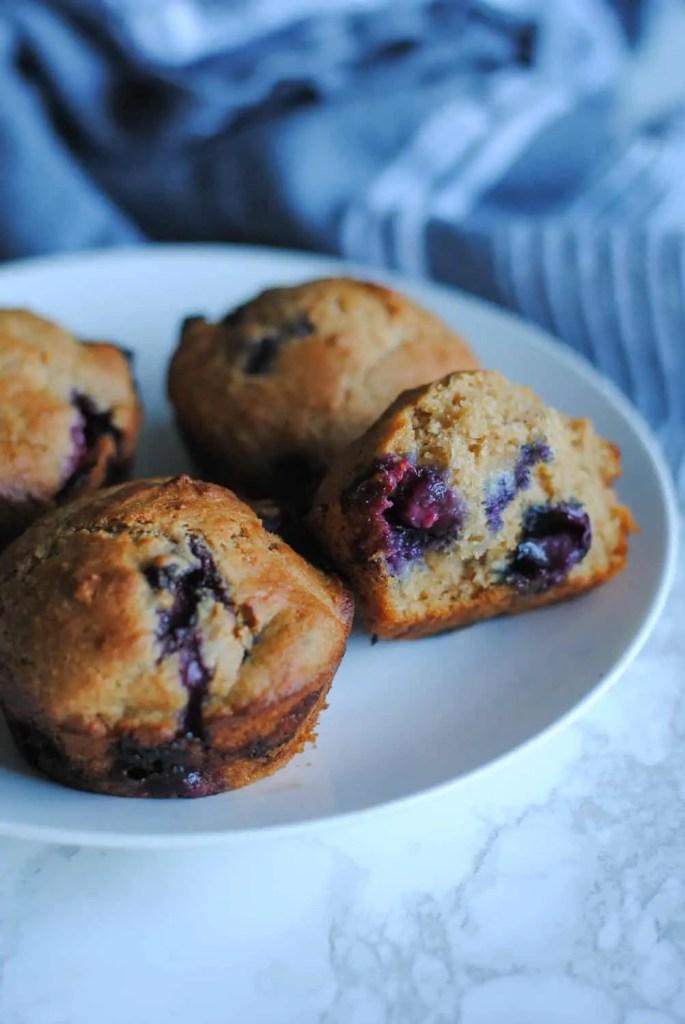 plate of whole wheat lemon blueberry muffins