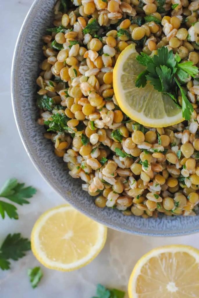 lentil and farro salad with lemon garnish