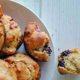 mixed berry muffins on white plate
