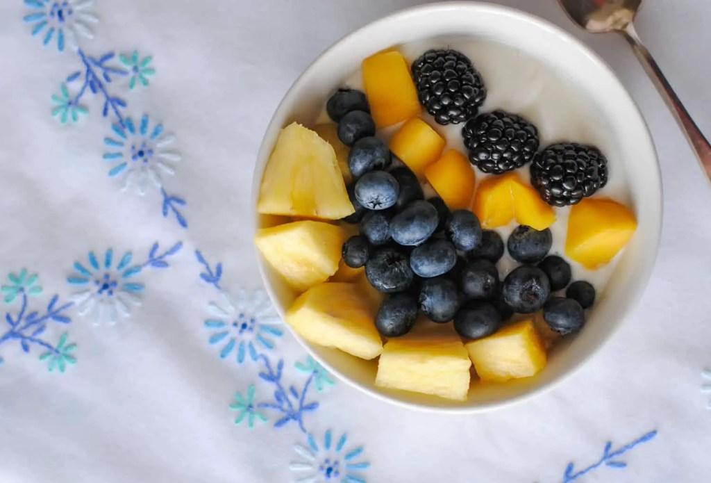 mangoes, blueberries, blackberries, pineapple - over yogurt
