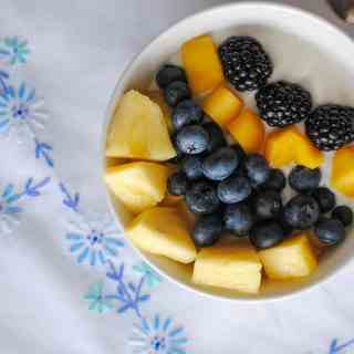 mangoes, blueberries, blackberries, pineapple - over yogurt