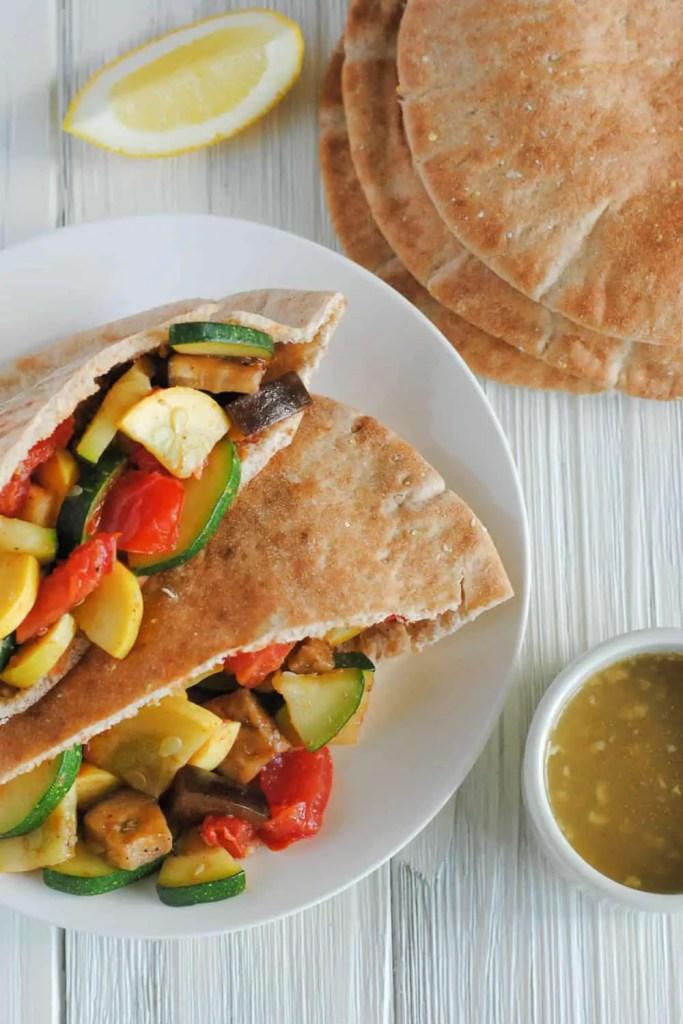 mediterranean veggie pitas on white plate