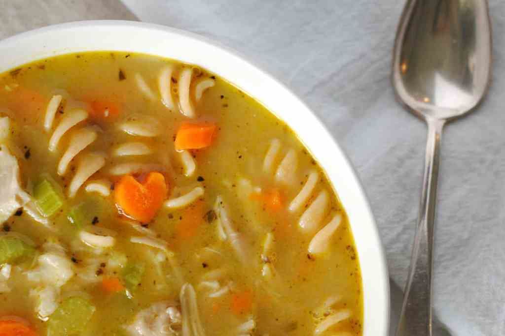 chicken soup in bowl on light background