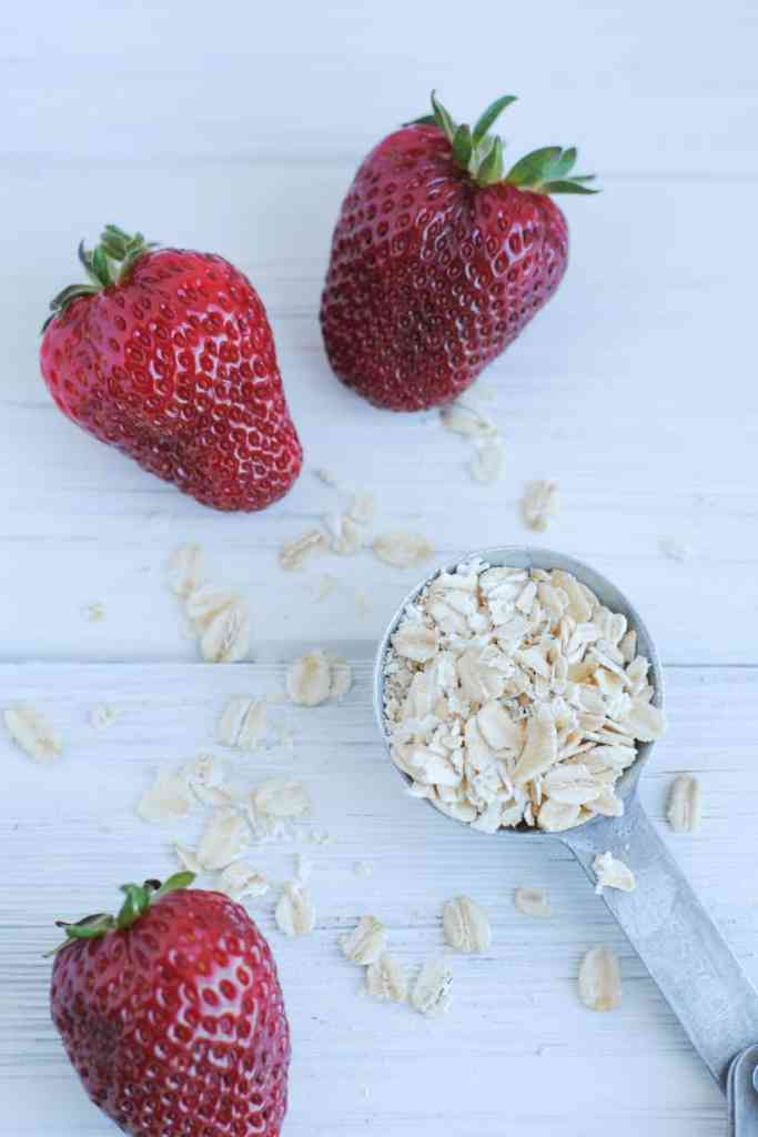 strawberries and oats on a white background