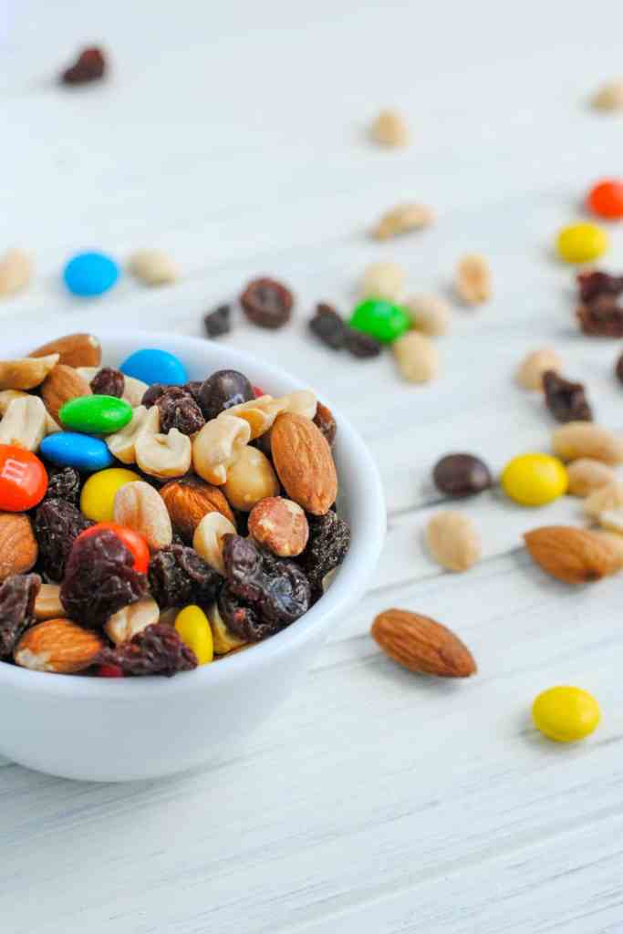 trail mix in bowl and on white background