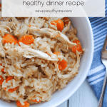 a bowl of chicken and rice with carrots on a white background with gray striped cloth and fork next to bowl. with text stating chicken & rice healthy dinner recipe neveranythyme.com