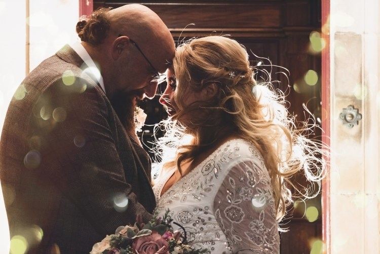bride and groom with foreheads together. romantic