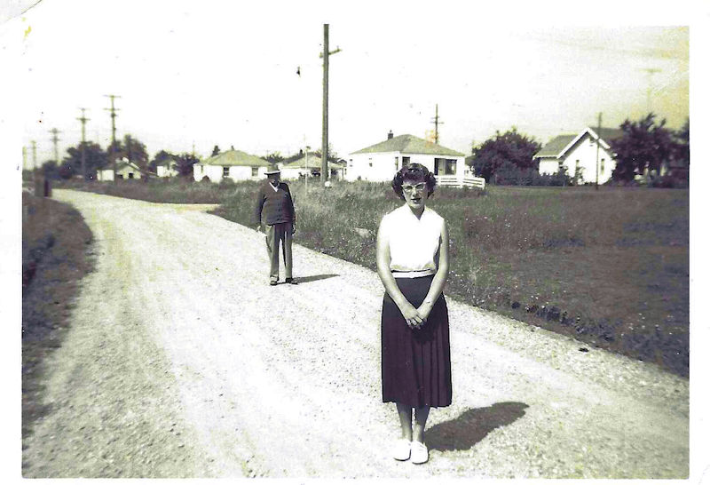 Woman in road with man stalking her