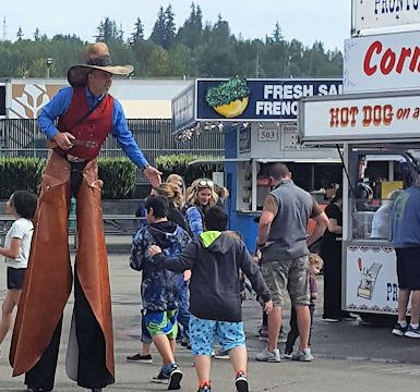 Walking on stilts at the county fair