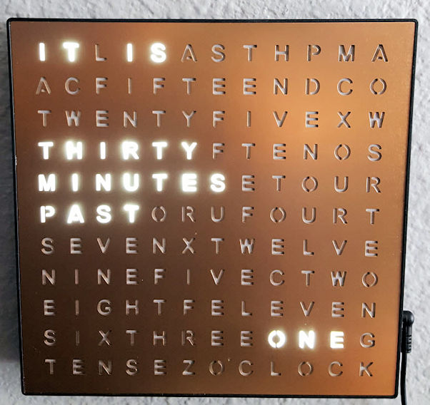 Clock that displays the time in sentence form, changing only every 5 minutes.