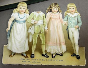 Porcelain doll scene seen at auction