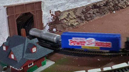 HO train coming out of a tunnel