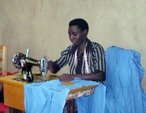 Tailor sews school uniform in Kabale