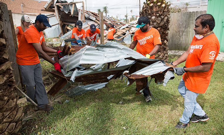 Samaritan's Purse volunteers remove debris from a Texas neighborhood