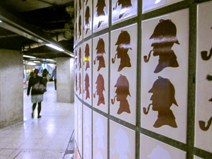 Holmes silouettes on underground station wall