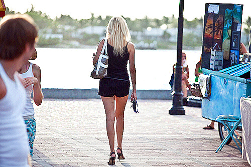men watching a woman walk by - what to do in Key West