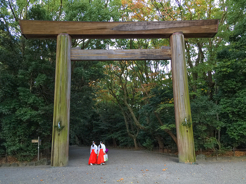 two women walking into a shrine in one of the best places in Japan