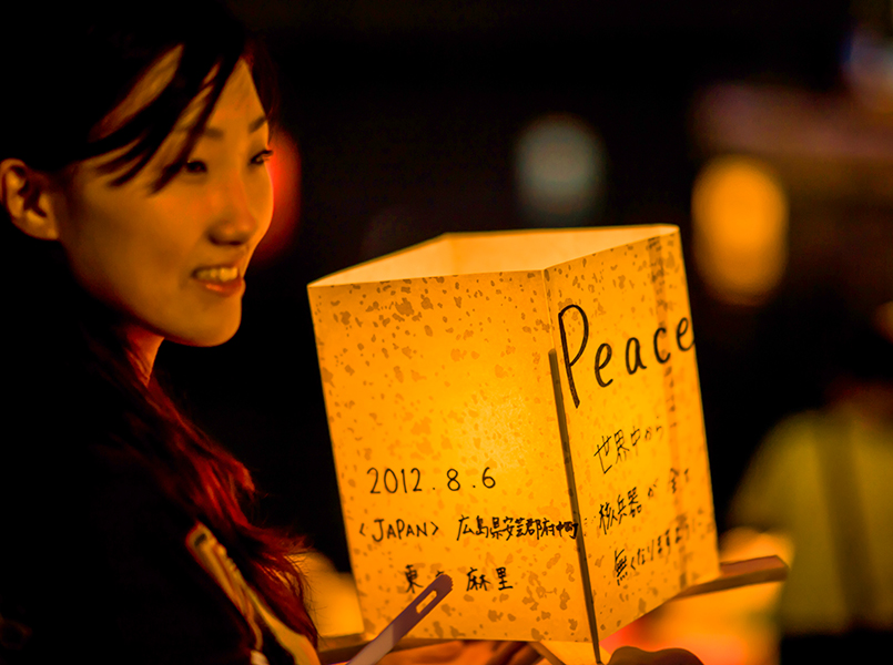 a woman with a peace latern