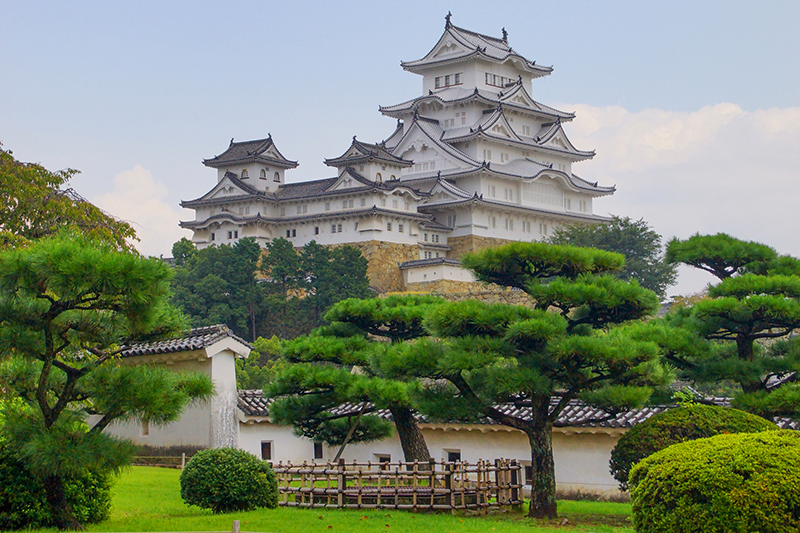 a castle on a hill in Japan