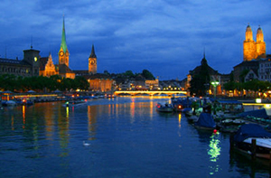 a city along a lake in the evening in Switzerland, one of the best places to visit in the country