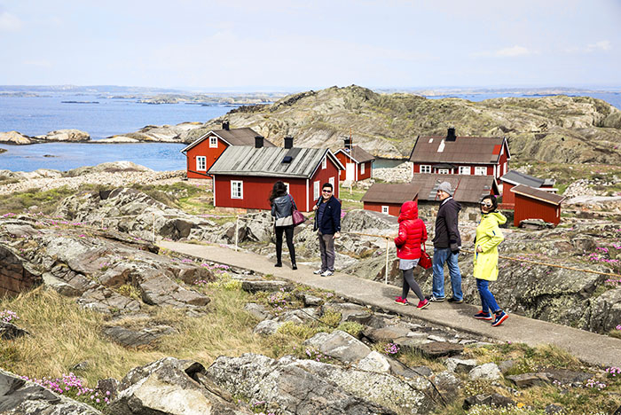 people and huts on a rocky island top 10 sweden