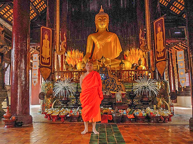 Budhist monk in a temple - top 10 places in Thailand