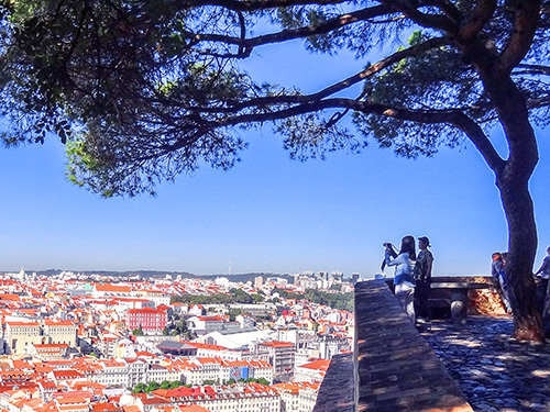 couple looking over a city in Portugal