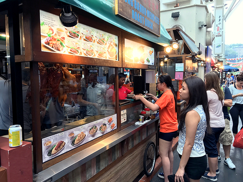 People at a hawker center in Singapore