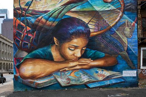 a wall mural showing public art in Philadelphia