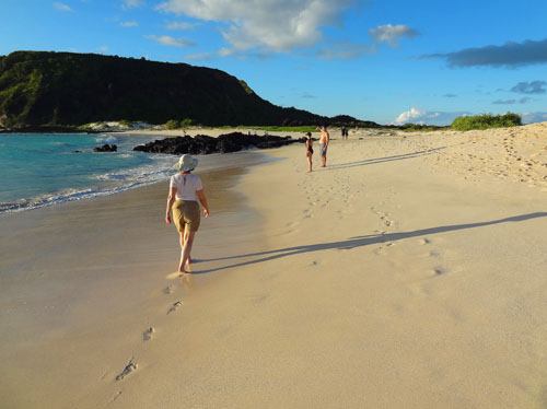 people on a deserted beach - How to get to the Galapagos Islands