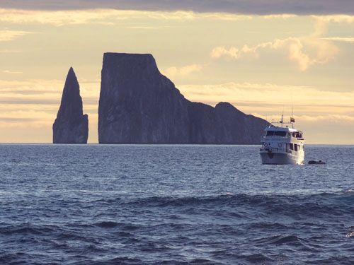 a hip by a huge rock - How to get to the Galapagos Islands