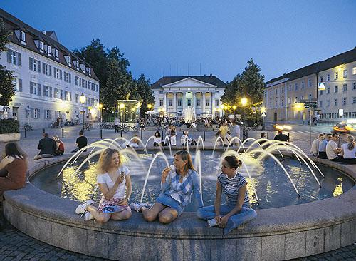 women by a fountain