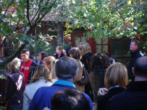 a group walking in a garden on a Beijing hutong tour