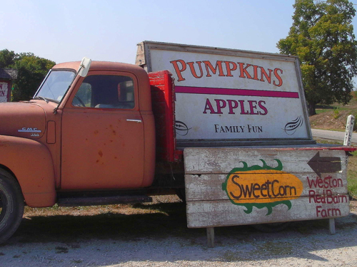 a truck at the red barn farm