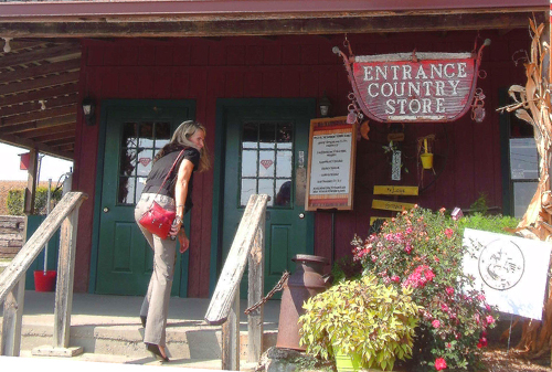 woman entering a country store, things to do in weston, mo