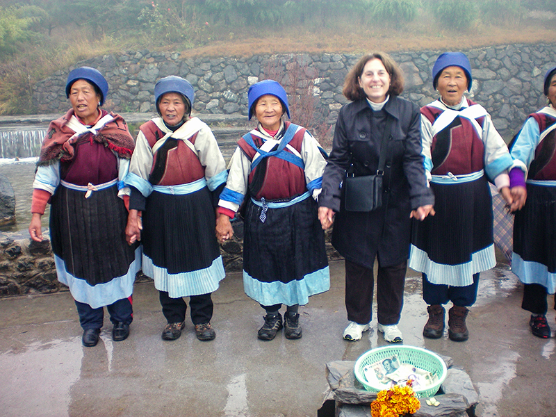 Marjorie with a group of Naxi women in Lijiang, China