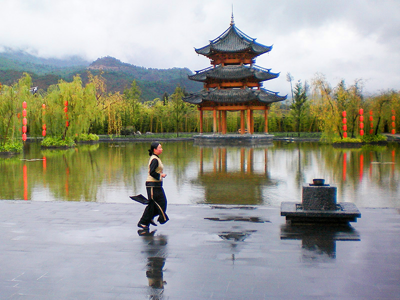 a woman and a pagoda in Lijang, Yunnan, China