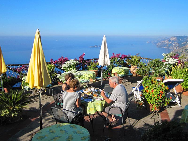 People having breakfast on a terrace in Nocelle