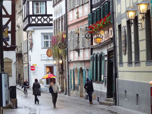 people walking past colorful buildings, one of the things to do in Bamberg, Germany