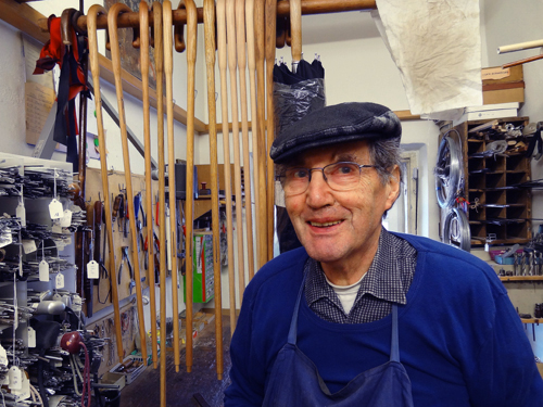 Umbrella maker Andreas Kirchtag in his shop
