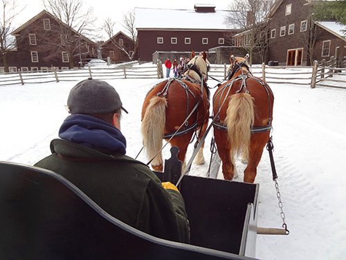 on a horse-drawn sleigh during our weekend getaway to Vermont