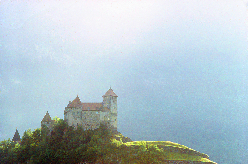 a castle on a hill in one of teh small countries of teh world