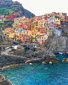 brightly colored houses by a harbor in Cinque Terre Italy